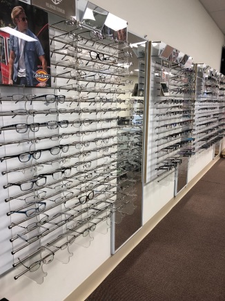 A wall of glasses within Salim Optical.